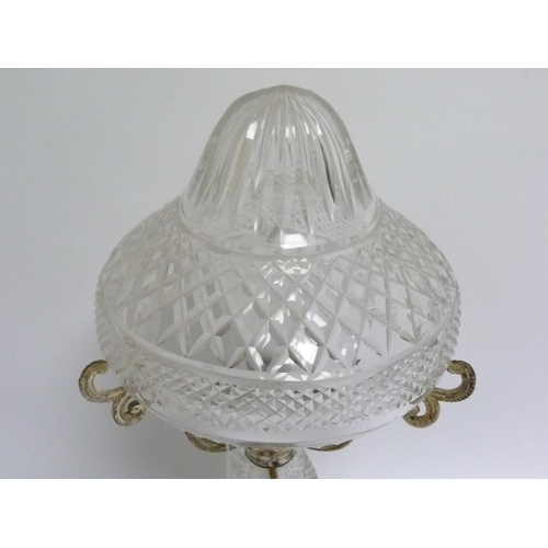 10 - Cut glass table lamp with baluster column, domed foot & domed shade on three e.p.n.s. scroll support...