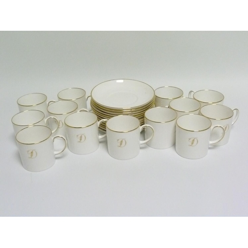 13 - Set of twelve Susie Cooper white & gilt bone china coffee cans & saucers, with gilt initial D, the c...