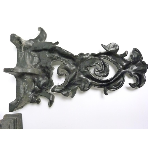 14 - Pair of black painted cast iron doorstops in the form of classical scrolling dolphins, each 41cm hig...