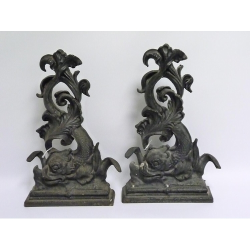 15 - Pair of black painted cast iron doorstops in the form of classical scrolling dolphins, each 41cm hig...