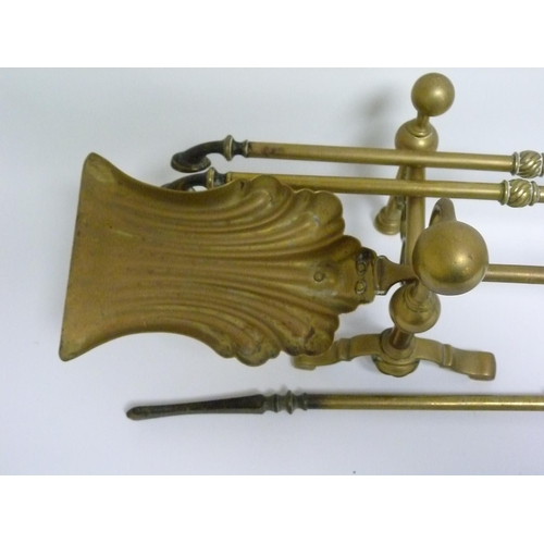 17 - Three piece brass companion set with foliate scroll handles & a pair of brass andirons with ball fin...