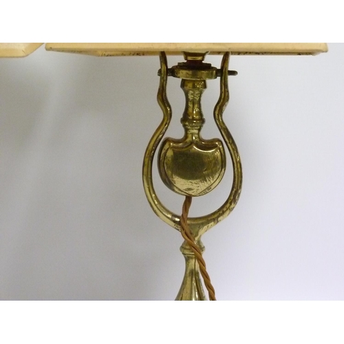 20 - Pair of gimballed brass table lamps, the shield shaped weight on wishbone supports, baluster column ...