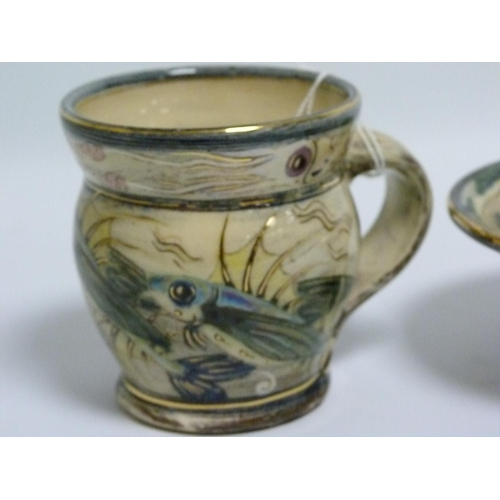 28 - Nick Chapman (B.1954) Devon studio pottery mug decorated with flying fish & squid, painted monogram,...