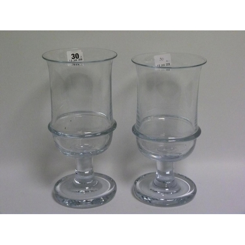 30 - Two large clear glass wine coolers or celery vases, the deep cylindrical bowls each with flared lip ...