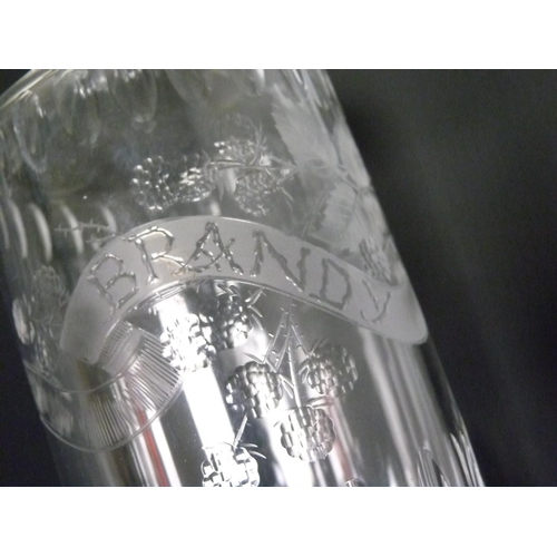 31 - Clear glass decanter of cylindrical form with cut faceting & etched decoration of blackberries &...
