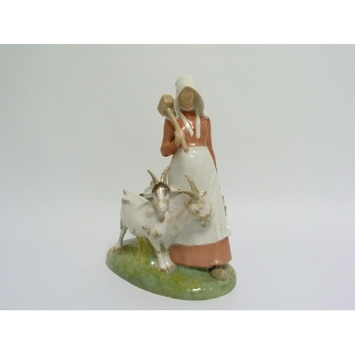 4 - Royal Copenhagen figure of a girl with two goats, no. 694, 24cm high....