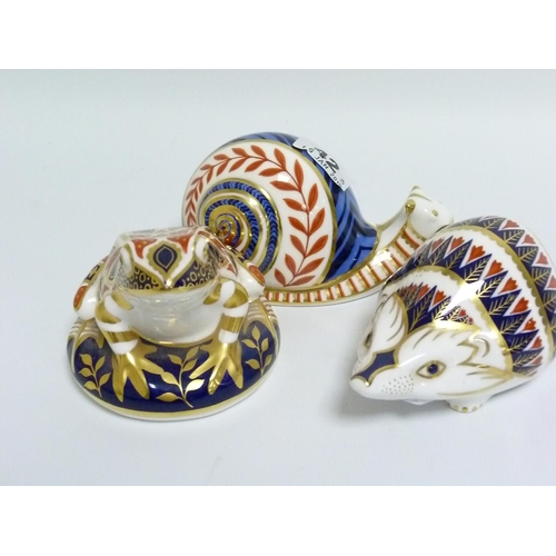 42 - Royal Crown Derby paperweight in the form of a Snail, 10cm high & two others in the form of a Frog, ...