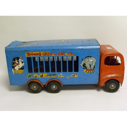 55 - Large Tri-ang tinplate circus van in worn condition, lacking animals, 59cm long....