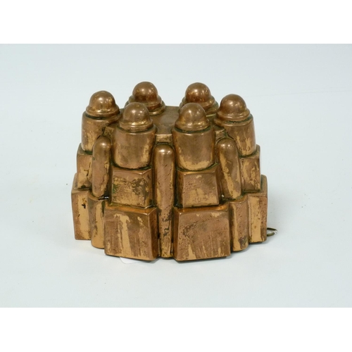 58 - Benham & Froud copper jelly mould of turreted form, no. 610 with impressed mark, 16cm wide & 13cm hi...