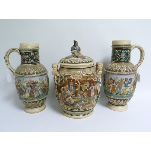 6 - Continental stoneware large covered twin handled jar & a pair of similar ewers with moulded decorati...
