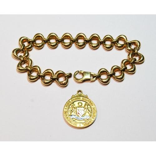 18 - 9ct gold bracelet of oval links and a similar medallion, 17g. (2)...