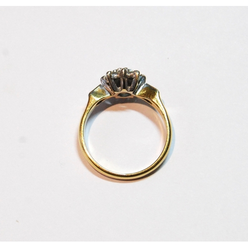 21 - Diamond daisy cluster ring with nine brilliants in 18ct gold, size N, 3.9g....