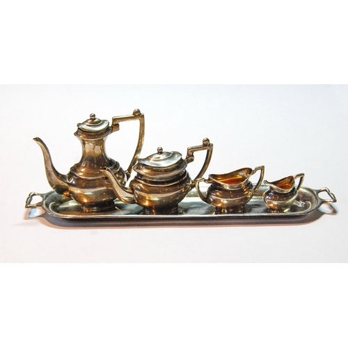 24 - Silver miniature four-piece tea and coffee set with tray, Henry Matthews, Birmingham 1905, cased....