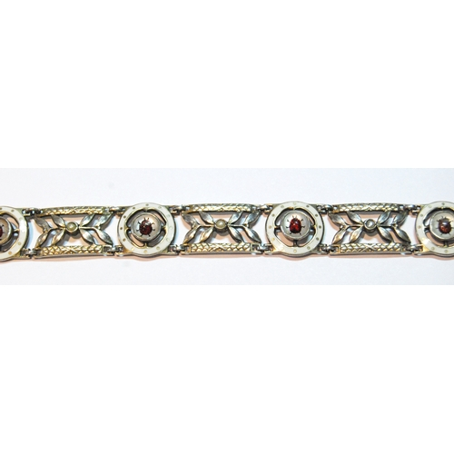 3 - Early 20th century white gold bracelet of six openwork panels and circular panels with tiny enamelle...