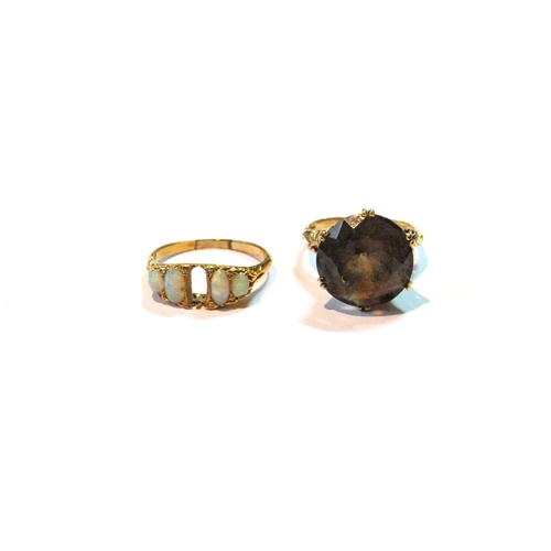 35 - Opal ring in gold, a/f, and another with citrine, 9ct....