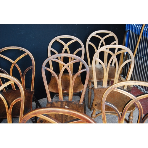 362 - Harlequin set of thirteen country chairs with arched Gothic backs.