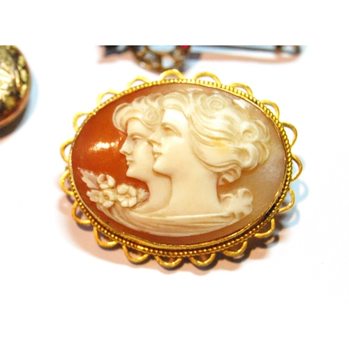 4 - Cameo brooch in gold, '9ct', two lockets, a crop and horseshoe brooch with rubies and diamonds, anot...