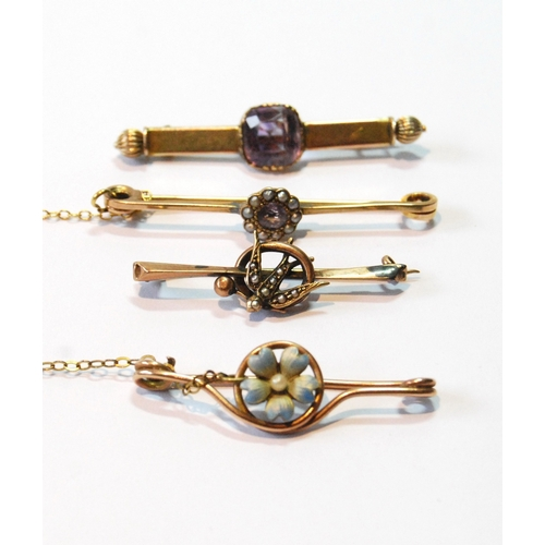 41 - Gold safety pin with enamelled flower and three others, similar....