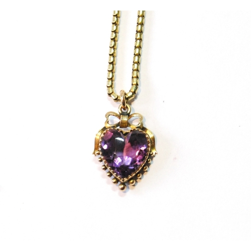 46 - 9ct gold heart locket with amethyst, 1893, on a snake necklet....