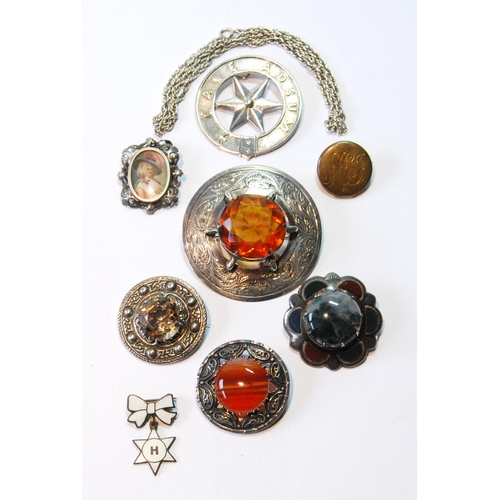 48 - Silver plaid brooch with cairngorm, another with various agates, and seven other items....