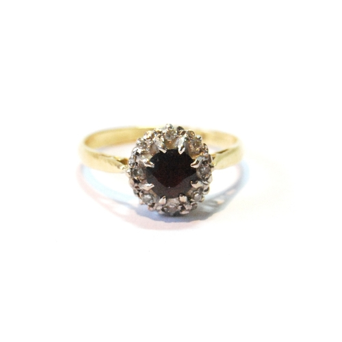 50 - Diamond and garnet cluster ring in 18ct gold, size T....