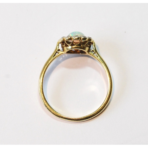 51 - Opal and diamond cluster ring, millegrain-set, in gold, '18ct', c. 1930, size R....