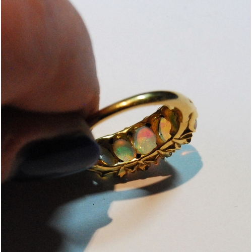 5A - Edwardian gold half hoop ring with five opals and diamond points, in gold, probably 18ct, size L....
