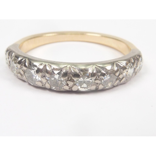 16 - Early 20th century diamond half hoop ring with eight brilliants in gold. Size 'M'. ...