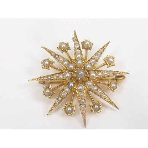 27 - Victorian gold and pearl star brooch of eight points with collets between, '15ct'....
