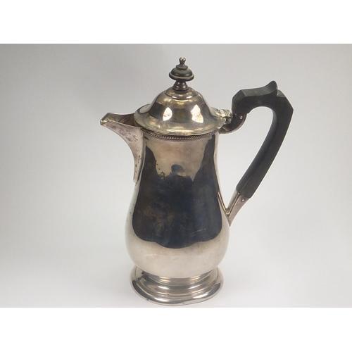 58 - Silver baluster hot water pot by Elkington & Co. Birmingham 1932.9 1/2 oz....