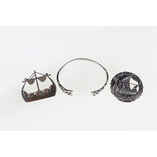 30 - Ola Gorie silver Viking Long-ship brooch, another similar by S & CO and a silver Celtic bracelet...
