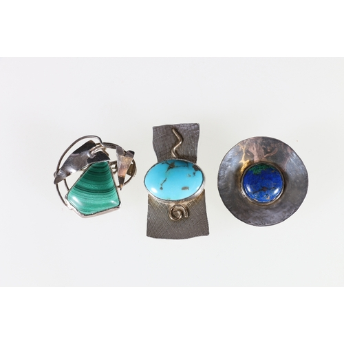 44 - Three silver brooches with inset polished stones, marked SMS, Edinburgh, 1996, 2000, 2007....