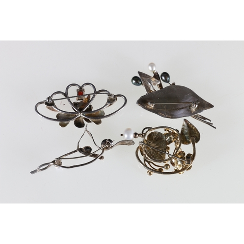 46 - Three silver floral brooches by SMS, Edinburgh with faux pearls and another with claw set red stone....