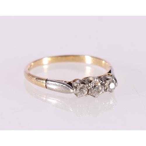 51 - 18ct gold and platinum diamond three stone ring, the central round diamond approximately 0.125ct, ri...