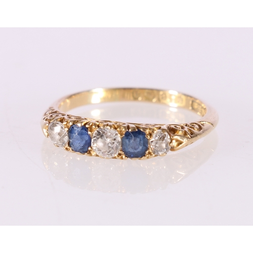 52 - 18ct gold diamond and sapphire five stone dress ring, the central round diamond approximately 0.21ct...