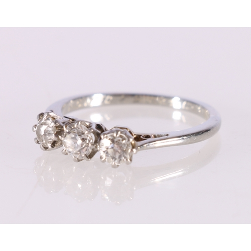 53 - 18ct white gold and platinum diamond three stone ring, the central round diamond approximately 0.25c...