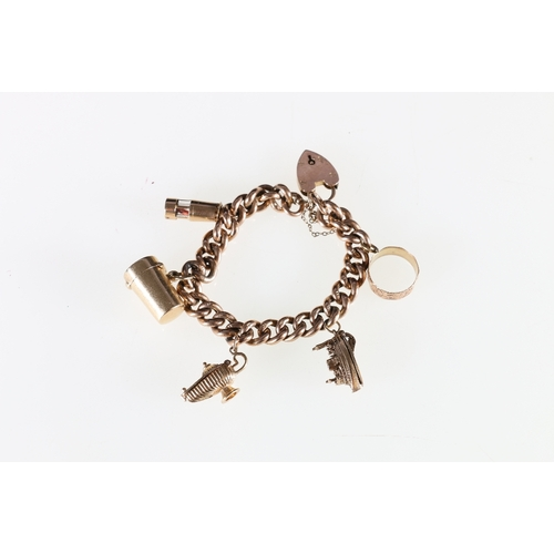 6 - 9ct yellow gold curb link charm bracelet with heart padlock closure having five hallmarked charms in...