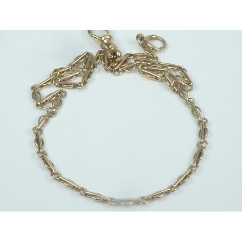 36 - Gold dress watch guard of fetter and ring pattern, '9ct'. 11.3g....