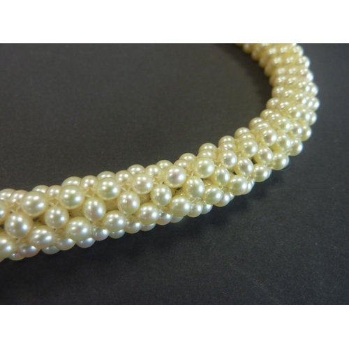 49 - Cultured pearl choker necklace of circular section on gold snap '585'....