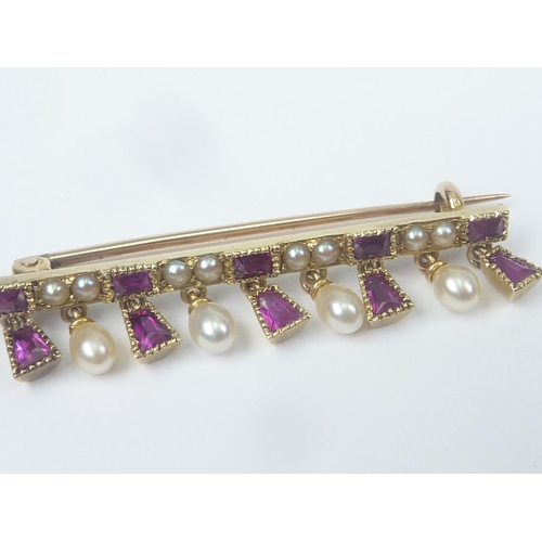 50 - Unusual Victorian gold brooch with alternating pearls and rubies dependant from the same....