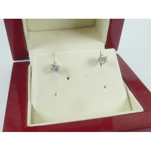 53 - Pair of diamond ear studs, each a brilliant given as .3ct (the pair) with a certificate....