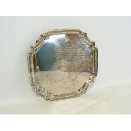 6 - Silver tray, square with moulded bowed edge on scroll feet inscribed and dated '.....years of war 19...