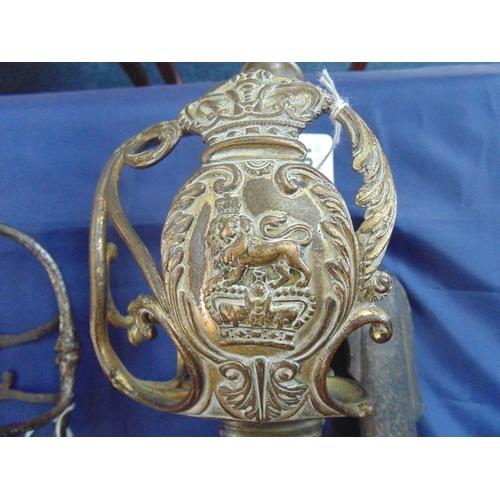 381 - British Household cavalry 1814 pattern sword with gilt brass basket type hilt having lion on coronet...
