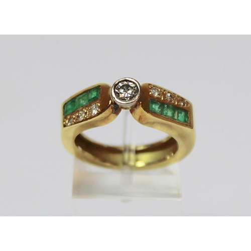 23 - Cocktail ring with collet set diamond flanked by mixed cut diamonds and emeralds. ' Size 'L'. 6.3g....