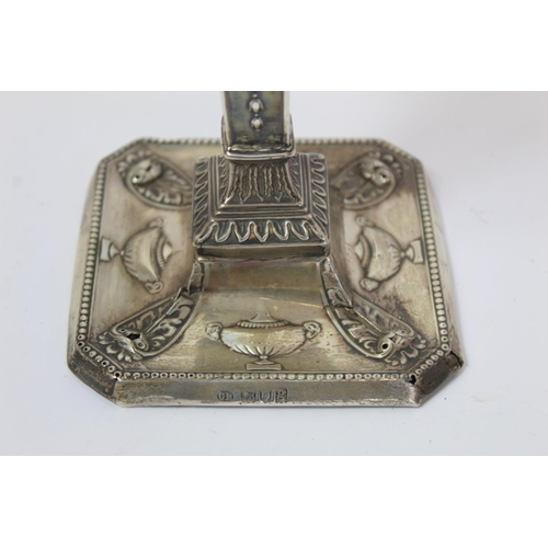 3 - Egyptian plain silver cigar box, 18cm square; also a candlestick 1902, loaded. (2)....