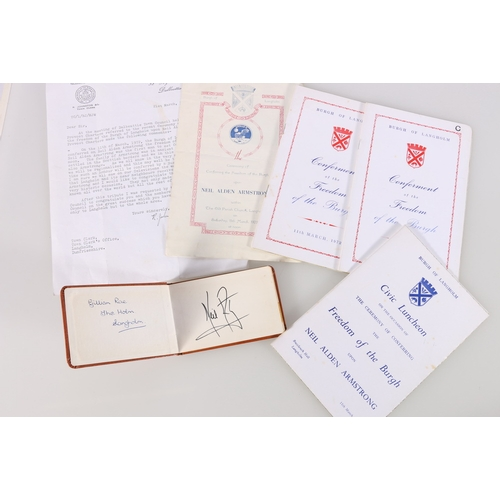 217 - Autograph book containing Astronaut Neil Alden Armstrong signature together with Burgh of Langholm e...