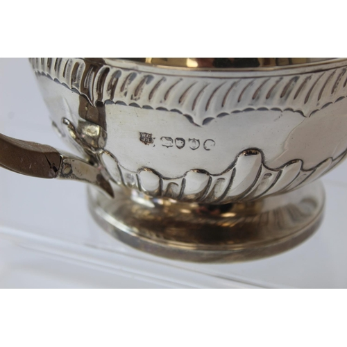 41 - Silver tea pot, hemispherical, with embossed flutes and milk jug by Gibson & Langman 1889. 28oz....