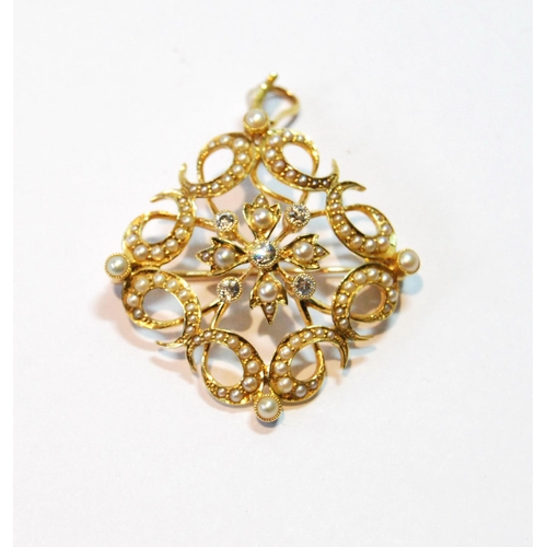 16 - Victorian gold brooch/pendant of square shape with diamond and pearl flowerhead within curls of grad...