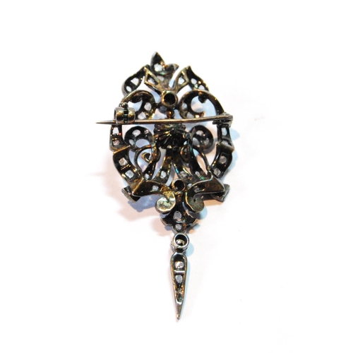 19 - Early Victorian brooch/pendant with a pearl and rose diamonds, in gold fronted with silver....