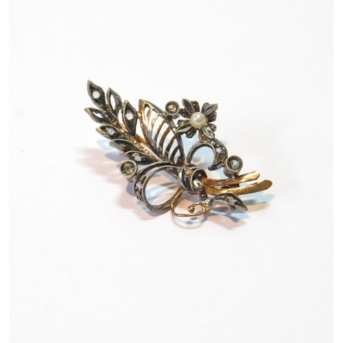 21 - 19th century spray brooch with a pearl and rose diamonds, in gold fronted with silver....